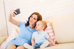 Mother with child playing in the home Royalty Free Stock Photos