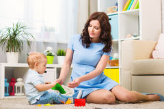 Mother with child playing in the home. Room Royalty Free Stock Photo
