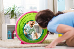 Mother with child playing in the home Stock Photography