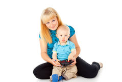 Mother with a child playing on the joystick Stock Photography