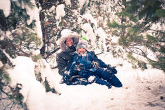 Mother and child playing outdoor in winter Royalty Free Stock Image