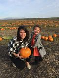 Mother and Child Playing in the Pumpkin Patch Stock Photo