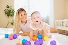 Mother and child are playing in the room. royalty free stock images