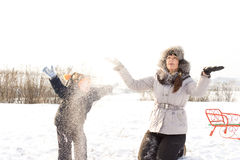 Mother and child playing in the snow Stock Images