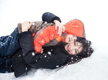 Mother and child playing in snow Royalty Free Stock Photo