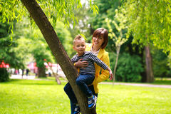Mother and child playing at summer city park on nature Stock Photo