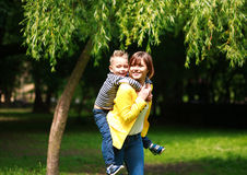 Mother and child playing at summer city park on nature Royalty Free Stock Photos