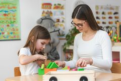 Mother and child Playing together with colorful didactic toys stock photo