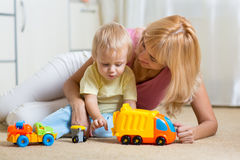 Mother with child playing together at home Stock Photo