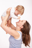 Mother and child playing together. Young Mother and pretty child royalty free stock photography