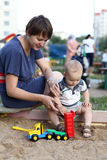 Mother and child playing with toy Stock Images