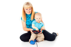 Mother with a child playing video games Stock Images