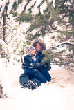 Mother and child playing in winter Royalty Free Stock Image