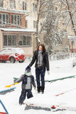 Mother with child plays snowballs Stock Photos