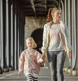 Mother and child on Pont de Bir-Hakeim bridge going forward Stock Images