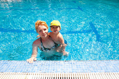 Mother and child in pool Royalty Free Stock Photo