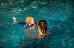Mother and child in pool stock photo