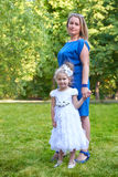 Mother and child posing on outdoor, woman and girl in city park, summer season. Mother and child posing on outdoor, women and girl in city park, summer season Stock Photography