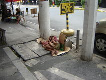 Mother and Child sleeping on street in Poverty in Manila Philippines Stock Images
