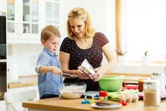 Mother and child preparing cookies Stock Photo