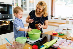Mother and child preparing cookies Royalty Free Stock Photo
