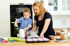 Mother and child preparing cookies Stock Photography