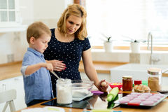Mother and child preparing cookies Stock Images