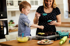 Mother and child preparing cookies Royalty Free Stock Image