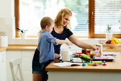 Mother and child preparing cookies. In kitchen royalty free stock photo