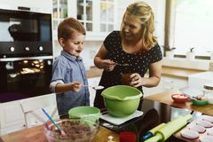 Mother and child preparing cookies. In kitchen royalty free stock photos