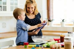 Mother and child preparing cookies. In kitchen Royalty Free Stock Images