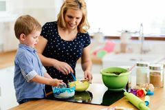 Mother and child preparing cookies. In kitchen stock photos