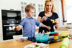 Mother and child preparing cookies Stock Image
