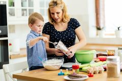 Mother and child preparing cookies. In kitchen Stock Image