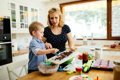Mother and child preparing cookies. In kitchen stock photo
