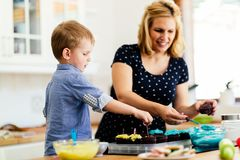 Mother and child preparing cookies. In kitchen Stock Photography
