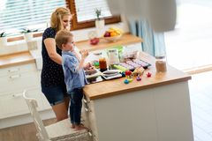 Mother and child preparing cookies. In kitchen royalty free stock image