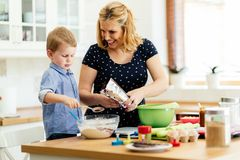 Mother and child preparing cookies. In kitchen stock images
