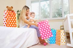 Mother with a child with presents and packages. stock photo