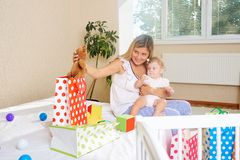 Mother with a child with presents and packages. stock photography
