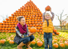 Mother and child with pumpkin Stock Images