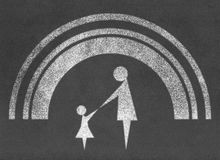 Mother and child with rainbow on chalkboard Stock Images