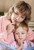 Mother and child read book Stock Images