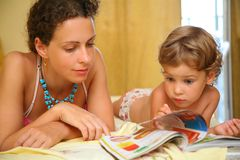 Mother and child read magazine Royalty Free Stock Photo