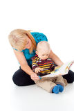 Mother and child reading a book Stock Images