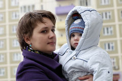 Mother with child in residential area Stock Photos
