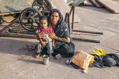 Mother with child rests on the courtyard of Jama Masjid Mosque Royalty Free Stock Image