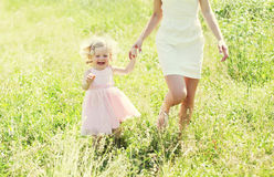 Mother and child running having fun together in sunny Royalty Free Stock Photos
