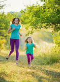 Mother with child running Stock Image