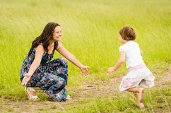 Mother and child. Child running to mother who is waiting with open arms Stock Image
